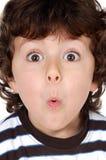 Visage de petit morceau d'enfant de surprise Photo libre de droits