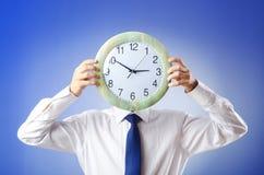 Visage de revêtement d'homme d'affaires avec l'horloge Image libre de droits