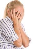 Visage de revêtement de femme avec des mains photos stock