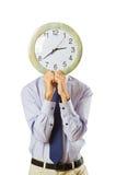 Visage de revêtement d'homme d'affaires avec l'horloge Photographie stock