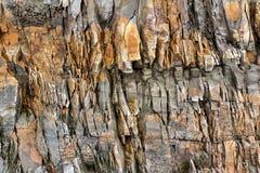 Visage de roche de granit, texture en pierre et fond photos stock