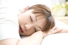 Visage de sommeil de femme japonais Image stock