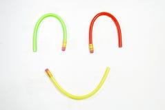 Visage de sourire avec le crayon mou Images libres de droits