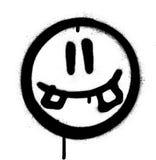 Visage de sourire idiot d'icône de graffiti dans le noir au-dessus du blanc Photographie stock