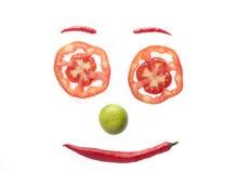 Visage de sourire par la tomate, le /poivron, et le citron Images stock