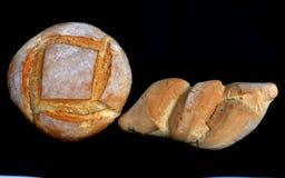 Visage du nord du pain et du petit pain se reposant là-dessus Image stock