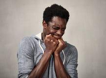 Visage effrayé d'homme de couleur photographie stock libre de droits