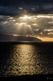 Visage en nuages au coucher du soleil Image stock