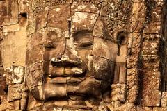 Visage en pierre au temple de Bayon, Cambodge Photos stock