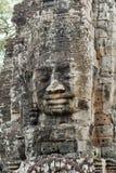 Visage en pierre sur le temple de Bayon chez Angkor Thom, Cambodi Photo libre de droits