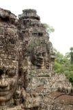 Visage en pierre sur le temple de Bayon chez Angkor Thom, Cambodi Photos libres de droits