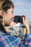 Visage et appareil-photo Photo stock