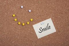 Visage heureux avec la note Images stock