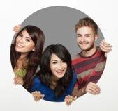 Visage heureux de trois amis Photo stock