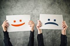 Visage heureux et triste. Photo stock