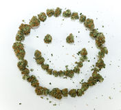 Visage heureux fait de marijuana Photographie stock