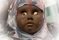 Visage noir effrayant de poupée Photo stock