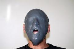Visage slimed par gris Photos libres de droits