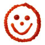 Visage souriant fait de sauce tomate Image stock