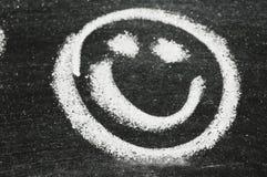 Visage souriant sur le tableau Photographie stock libre de droits