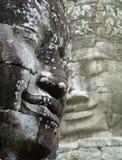 Visages dans le thom d'angkor Photos libres de droits