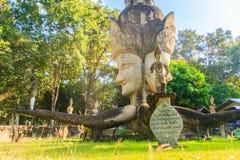 4 visages de Brahma chez Sala Keoku, le parc de l'escroquerie fantastique géante Images libres de droits