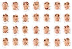 Visages de l'homme dans un trou de papier Photos libres de droits