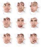 Visages de l'homme dans un trou de papier Images libres de droits