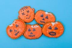 Visages de pain d'épice de Halloween Photographie stock