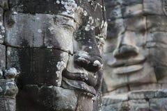 Visages de pierre de Bouddha au temple de Bayon photos libres de droits