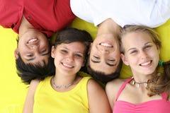 Visages de sourire heureux   Photo stock