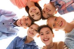 Visages de sourire heureux d'enfants Photo stock