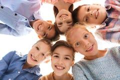 Visages de sourire heureux d'enfants Photographie stock