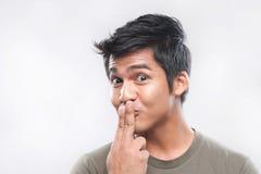 Visages drôles d'homme asiatique Photographie stock libre de droits