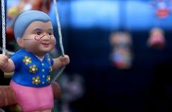 Visages heureux d'argile de poupée pour la décoration dans le jardin Image stock