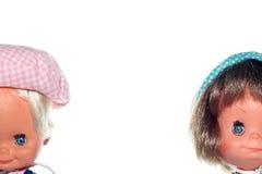 Visages heureux de poupée de garçon et de fille Photos stock
