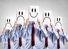 Visages heureux et négatifs Photo stock