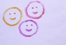 Visages heureux sur un fond blanc Images stock