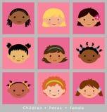 Visages mignons des filles de l'appartenance ethnique différente Photographie stock libre de droits