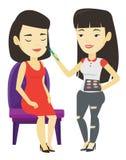 Visagiste doing makeup to young stylish girl. Royalty Free Stock Photo