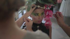 Visagiste makes makeup for  model, professional makeup artist tints the model's eye,makeup,  body art stock video