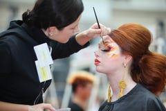 Visagiste makes original makeup for model Royalty Free Stock Image