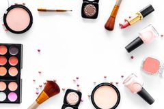 Visagiste work table with decorative cosmetics of beige and nude tones set white background top view mockup Royalty Free Stock Photos