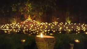 Visakha Bucha Day, candles in religious ceremony, Chiang mai Thailand. stock video footage