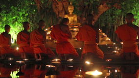 Visakha Bucha Day. CHIANG MAI THAILAND - JUNE 1 : Visakha Bucha Day is the most important incidents Buddhist day. Buddhist monk fire candles to the Buddha. Jun 1 stock footage