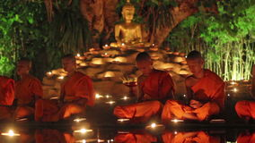 Visakha Bucha Day. CHIANG MAI THAILAND - JUNE 1 : Visakha Bucha Day is the most important incidents Buddhist day. Buddhist monk fire candles to the Buddha. Jun 1 stock video