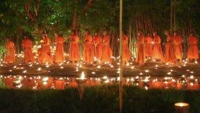 Visakha Bucha Day , Chiangmai, Thailand. CHIANG MAI THAILAND - MAY 20 : Visakha Bucha Day is the most important incidents Buddhist day. Buddhist monk fire stock footage