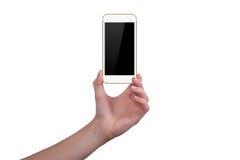 Visar den guld- telefonen i en hand Royaltyfri Foto