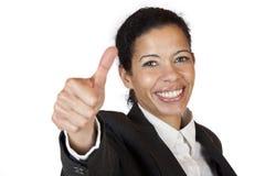 visar den säkra själven för affären tumen upp kvinna Arkivfoto