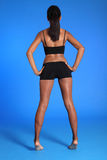 visar fit bakre sportar för afrikansk amerikanhuvuddel womans Arkivfoton